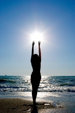 woman reaching sun